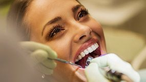 Woman receving dental treatment