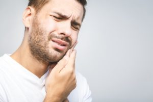 Man experiencing a toothache