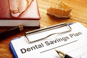 dental savings plan with clipboard on desk