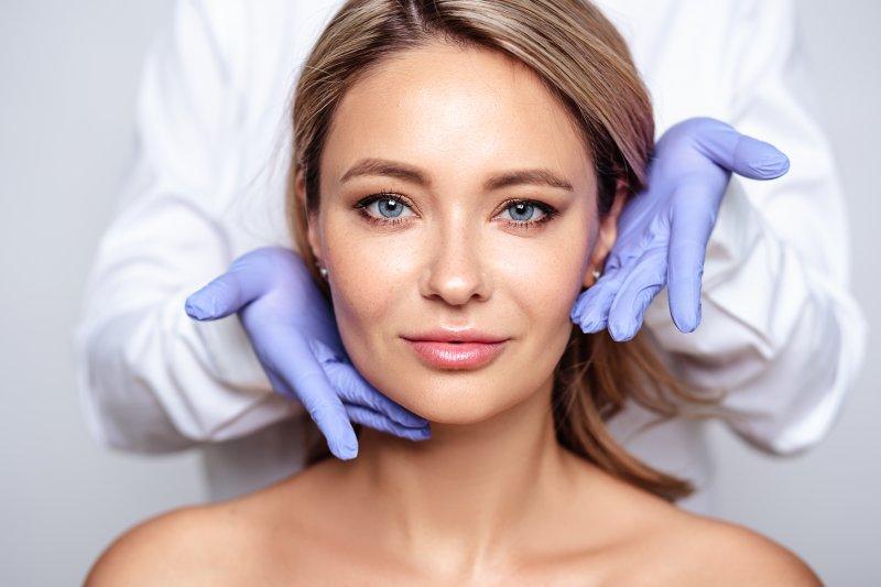 Closeup of woman smiling after BOTOX treatment